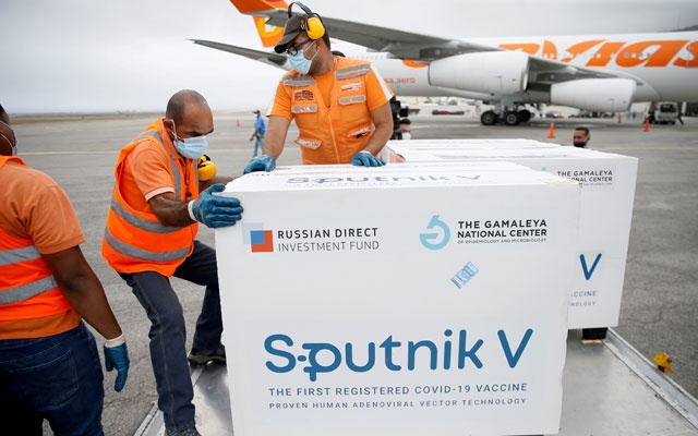 Workers take care of the shipment of Russia's Sputnik V vaccine against the coronavirus disease (COVID-19) at the airport, in Caracas, Venezuela March 29, 2021. REUTERS
