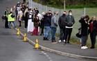 People line up outside a mobile vaccination centre, amid the outbreak of the coronavirus disease (COVID-19), in Bolton, Britain, May 13, 2021. REUTERS