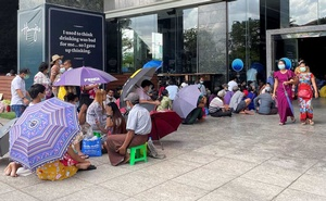 People line up outside a bank to withdraw cash, in Yangon, Myanmar May 13, 2021. REUTERS/Stringer