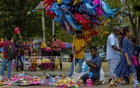 Vendors sell balloons, balls, toy aeroplanes and dolls made of mainly plastic and rubber at the Central Shaheed Minar premises in Dhaka on Saturday, May 15, 2021 after Eid-ul-Fitr. None of them have traditional clay toys or dolls. Photo: Mahmud Zaman Ovi