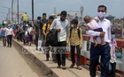 A crowd of people returning to Dhaka after Eid walk along the Aminbazar Bridge on Sunday, May 16, 2021. Photo: Asif Mahmud Ove