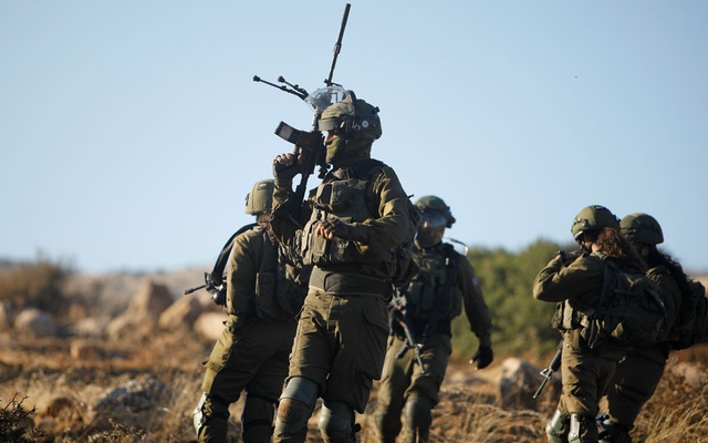 Israeli soldiers patrol the area following a flare-up of Israeli-Palestinian violence, near Tubas in the Israeli-occupied West Bank, May 15, 2021. REUTERS