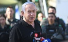 Israeli Prime Minister Benjamin Netanyahu speaks during meeting with Israeli border police following violence in the Arab-Jewish town of Lod, Israel May 13, 2021. Yuval Chen/Pool via REUTERS