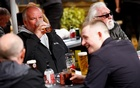 Customers at The Swinging Witch pub enjoy drinks, as lockdown eases amid the coronavirus disease (COVID-19) pandemic, in Northwich, Cheshire, Britain, May 15, 2021. REUTERS