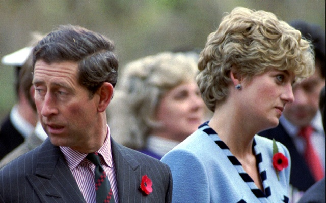 Princess Diana and Prince Charles look in different directions, November 3, during a service held to commemorate the 59 British soldiers killed in action during the Korean, Nov. 3, 1992. Reuters