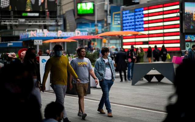 People make their way through Times Square, amid the coronavirus disease (COVID-19) pandemic, in Manhattan, New York City, US, May 07, 2021. REUTERS