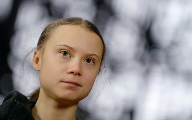 Swedish climate activist Greta Thunberg talks to the media before meeting with EU environment ministers in Brussels, Belgium, March 5, 2020. REUTERS