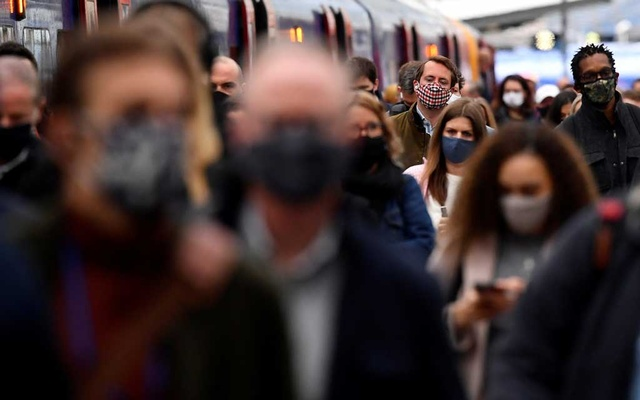 FILE PHOTO: People travel through Waterloo railway station during the morning rush hour as coronavirus disease (COVID-19) restrictions continue to ease throughout the country, London, Britain, May 19, 2021. REUTERS