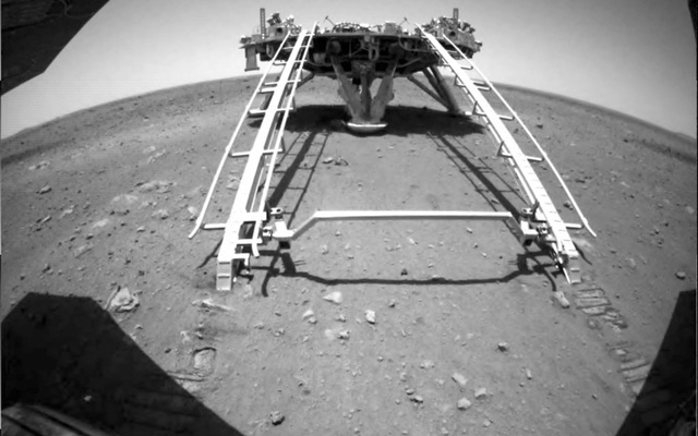 Chinese rover Zhurong of the Tianwen-1 mission drives down the ramp of the lander onto the surface of Mars, in this screenshot taken from a video released by China National Space Administration (CNSA) May 22, 2021. CNSA/Handout via REUTERS