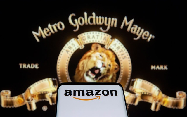 Smartphone with Amazon logo is seen in front of displayed MGM logo in this illustration taken, May 26, 2021. Reuters
