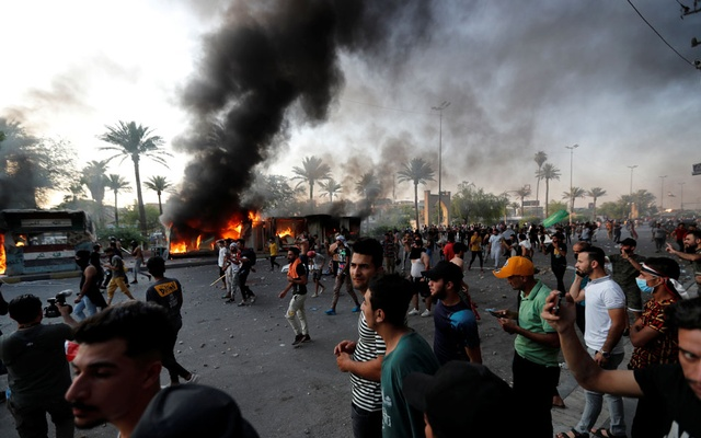 Demonstrators gather near a fire site during an anti-government protest in Baghdad, Iraq May 25, 2021. REUTERS
