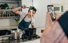 """Eitan Bernath, a 19-year-old TikTok star with more than 1.6 million followers, films a cooking video at his home in New York, May 17, 2021. """"TikTok is the biggest thing that happened to me in my career, and honestly the reason why I am where I am today,"""" said Bernath. The New York Times"""