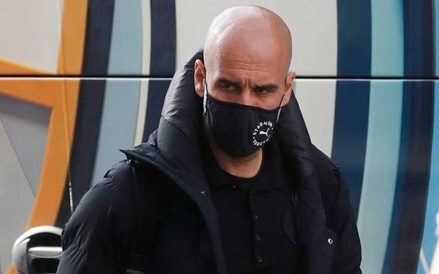 Football - Champions League - Manchester City arrive at their hotel ahead of the Champions League Final - Porto, Portugal - May 27, 2021 Manchester City manager Pep Guardiola wearing a protective face mask arrives to the hotel REUTERS/Pedro Nunes