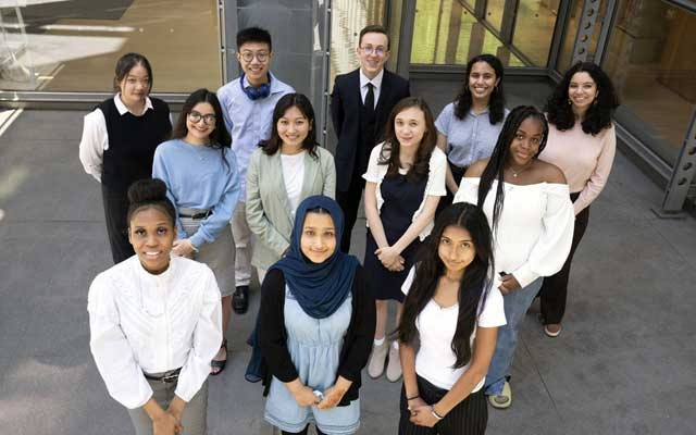 This year's winners of New York Times college scholarships in New York on May 17, 2021. Back row, from left: Jenifer Weng, Brian Zhang, Alex Koiv, Lamia Haque, Aima Ali. Center row, from left: Nikole Rajgor, Enlik Tagasheva, Tigerlily Hopson, Danielle Knight. Front row, from left: Jelyse Williams, Samia Afrin, Jailene Sinchi. (James Estrin/The New York Times)