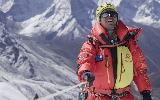 Chinese mountaineer Zhang Hong, the first blind Asian person to scale Mount Everest, smiles after reaching the top of a difficult section of the climb. Photo: InHope Pictures