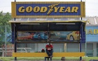 A woman sits at a bus stop outside Goodyear factory in Shah Alam, Malaysia May 6, 2021. REUTERS
