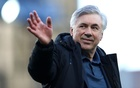 Football - Premier League - Everton v Wolverhampton Wanderers - Goodison Park, Liverpool, Britain - May 19, 2021 Everton manager Carlo Ancelotti waves to fans during a lap of appreciation after the match, as a limited number of fans are permitted at outdoor sports venues. Pool via REUTERS/Jan Kruger