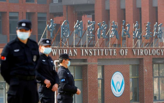 Security personnel keep watch outside the Wuhan Institute of Virology during the visit by the World Health Organisation (WHO) team tasked with investigating the origins of the coronavirus disease (COVID-19), in Wuhan, Hubei province, China February 3, 2021. REUTERS