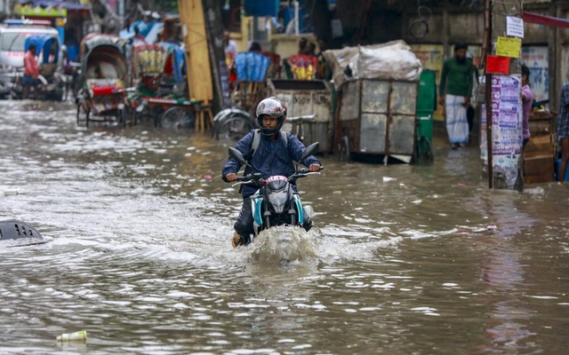 Vehicles move through knee-deep water on Green Road in Dhaka after hours of incessant rains on Tuesday, Jun 1, 2021.