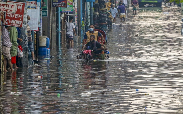 The street outside Sayedabad Bus Terminal in Dhaka goes under water after incessant rains for hours on Tuesday, Jun 1, 2021.