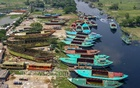 Anchored sand carriers that need repair wait for the reopening of the dockyard at Itakhola in Dhaka's Demra for months. Photo: Mahmud Zaman Ovi