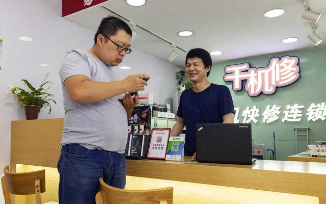 Huang Yulong, who had a vasectomy at 26 and plans to remain childless, near his apartment in Guangzhou, China, on May 24, 2021. He is striving for a lifestyle known as