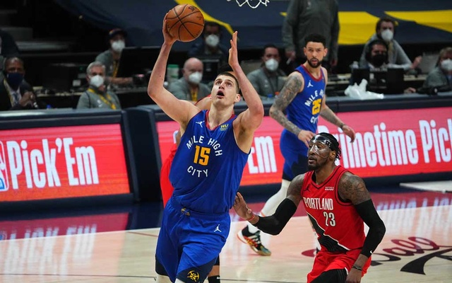 Jun 1, 2021; Denver, Colorado, USA; Denver Nuggets centre Nikola Jokic (15) shoots past Portland Trail Blazers forward Robert Covington (23) in the first quarter during game five in the first round of the 2021 NBA Playoffs. at Ball Arena. Ron Chenoy-USA TODAY Sports