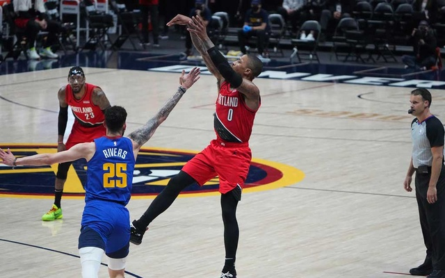 Jun 1, 2021; Denver, Colorado, USA; Portland Trail Blazers guard Damian Lillard (0) shoots a three-point basket over Denver Nuggets guard Austin Rivers (25) in the third quarter during game five in the first round of the 2021 NBA Playoffs. at Ball Arena. Ron Chenoy-USA TODAY Sports