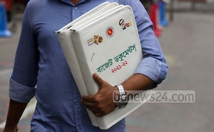 Media workers leave the parliament building with documents after being denied entry to join the budget session for fiscal 2021-22 to prevent the risk of coronavirus transmission. Photo: Asif Mahmud Ove