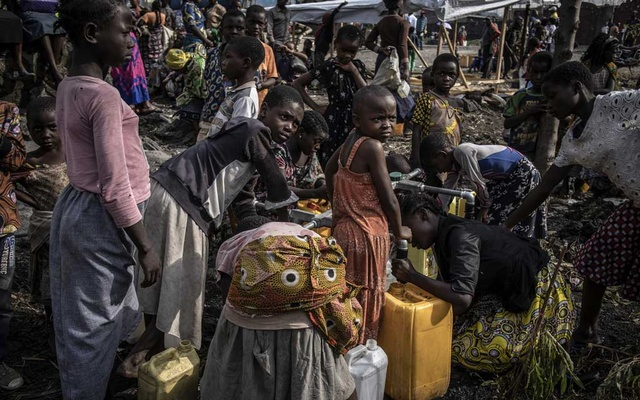 Children collect water at an emergency distribution point in the town of Sake in eastern Democratic Republic of Congo on Wednesday, June 2, 2021. Mount Nyiragongo exploded on May 22, leaving hundreds of thousands of displaced people amid threats of new disasters. (Finbarr O'Reilly/The New York Times)