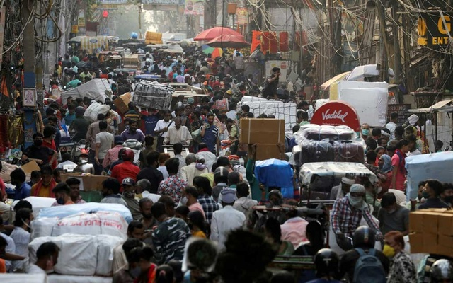 People walk at a crowded market in the old quarters of Delhi, India, April 6, 2021. REUTERS