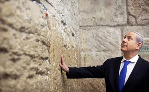 Israel's Prime Minister Benjamin Netanyahu touches the Western Wall in Jerusalem's Old City after casting his ballot for the parliamentary election January 22, 2013. Reuters