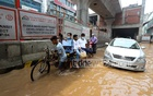 Office-goers faced a difficult commute after heavy rains on Saturday morning caused waterlogging on the streets of Kazipara in Dhaka's Mirpur on Jun 5, 2021. Photo: Asif Mahmud Ove