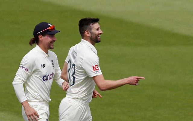 Cricket - First Test - England v New Zealand - Lord's Cricket Ground, London, Britain - June 6, 2021 England's Mark Wood celebrates with Rory Burns after taking the wicket of New Zealand's Ross Taylor Action Images via Reuters/Andrew Couldridge