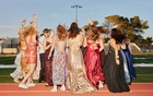 Dancing on the track around the football field during prom at Petaluma High School in Petaluma, Calif, May 30, 2021. The New York Times