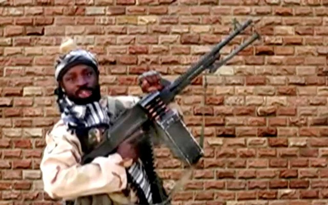 Boko Haram leader Abubakar Shekau holds a weapon in an unknown location in Nigeria in this still image taken from an undated video obtained on Jan 15, 2018. REUTERS
