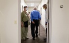Henry Magendantz, center, a participant in the clinical trial of the experimental Alzheimer's drug, aducanumab, with his wife, Kathy Jellison, and Dr. Stephen Salloway, leaving the hospital after receiving an infusion in Providence, Rhode Island on May 27, 2021. The Food and Drug Administration on Monday, June 7, 2021, approved the first new medication for Alzheimer's disease in nearly two decades, a contentious decision, made despite opposition from the agency's independent advisory committee and some Alzheimer's experts who said there was not enough evidence that the drug can help patients. (Kayana Szymczak/The New York Times)