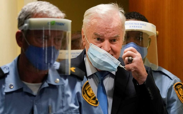 Former Bosnian Serb military leader Ratko Mladic enters the courtroom prior to the pronouncement of his appeal judgement at the UN International Residual Mechanism for Criminal Tribunals (IRMCT) in The Hague, Netherlands June 8, 2021. Peter Dejong/Pool via REUTERS