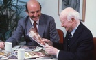 A photo provided via Scholastic shows Richard Robinson, left, in 1980 with his father, Maurice Robinson, who founded Scholastic in 1920. The New York Times