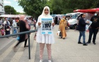 French local election candidate Sara Zemmahi, wearing a hijab, holds her campaign flyer with the slogan 'Different, but united for you' as she poses during an interview for Reuters ahead of the upcoming French local elections in the La Mosson market in Montpellier, France, Jun 5, 2021. REUTERS