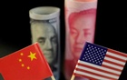 US and Chinese flags are seen in front of a US dollar banknote featuring American founding father Benjamin Franklin and a China's yuan banknote featuring late Chinese chairman Mao Zedong in this illustration picture taken May 20, 2019. REUTERS