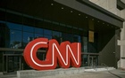 """Outside CNN headquarters in Atlanta, Dec 10, 2020. CNN disclosed on Wednesday, Jun 9, 2021, that it had fought a secret legal battle with the Justice Department over prosecutors' attempt to seize """"tens of thousands"""" of email logs of one of its reporters — and that as part of the fight, the government had imposed a gag order on the network's lawyers and its president, Jeff Zucker. Audra Melton/The New York Times"""