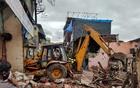 Rescue workers search for survivors in the debris after a residential building collapsed in Mumbai, India, June 10, 2021. REUTERS
