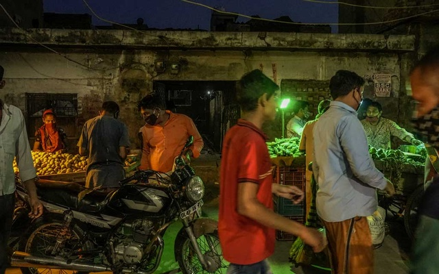The Nangli Vihar market in New Delhi, May 25, 2021. The neighbourhood, which has become more or less desolate throughout the day due to the coronavirus pandemic, now comes to life during market evenings on Tuesday and Friday. Atul Loke/The New York Times