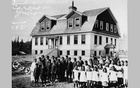 Students pose in front of the Chooutla Indian Residential School, a residential school in the Carcross/Tagish First Nation community of Carcross, Yukon Territories, Canada in 1921.
