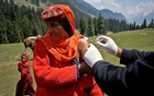 A shepherd woman receives a dose of COVISHIELD, a coronavirus disease (COVID-19) vaccine manufactured by Serum Institute of India, during a vaccination drive at Lidderwat near scenic Pahalgam in south Kashmir's Anantnag district, June 10, 2021. REUTERS/Sanna Irshad Mattoo