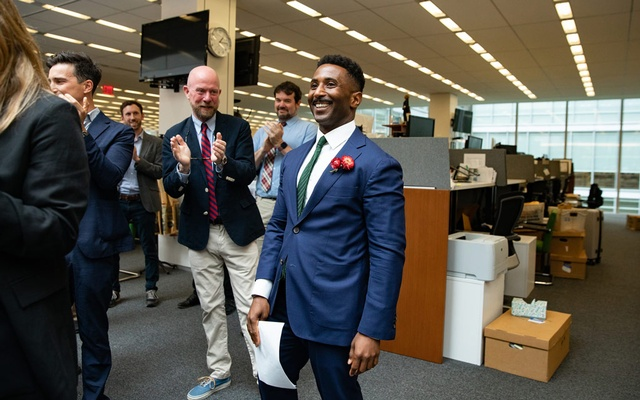 Wesley Morris, critic-at-large, is congratulated by colleagues after being awarded the Pulitzer Prize for criticism, in the newsroom at The New York Times headquarters in New York, on Friday, June 11, 2021. (Damon Winter/The New York Times)