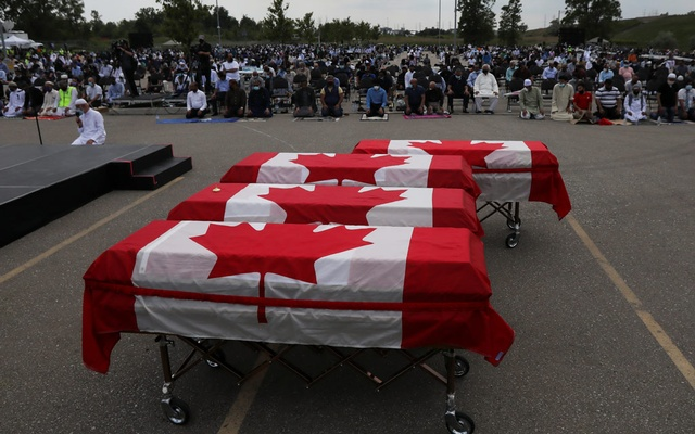 Flag-wrapped coffins are seen outside the Islamic Centre of Southwest Ontario, during a funeral of the Afzaal family that was killed in what police describe as a hate-motivated attack, in London, Ontario, Canada June 12, 2021. REUTERS