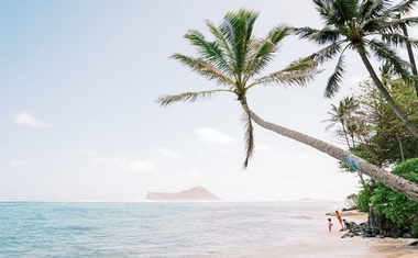 Tourists play on a beach in Waimanalo on Oahu, Hawaii, on March 10, 2021.The New York Times