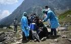 A healthcare worker administers a dose of COVISHIELD, a coronavirus disease (COVID-19) vaccine manufactured by Serum Institute of India, to a shepherd man during a vaccination drive at Lidderwat near scenic Pahalgam in south Kashmir's Anantnag district, June 10, 2021. Reuters